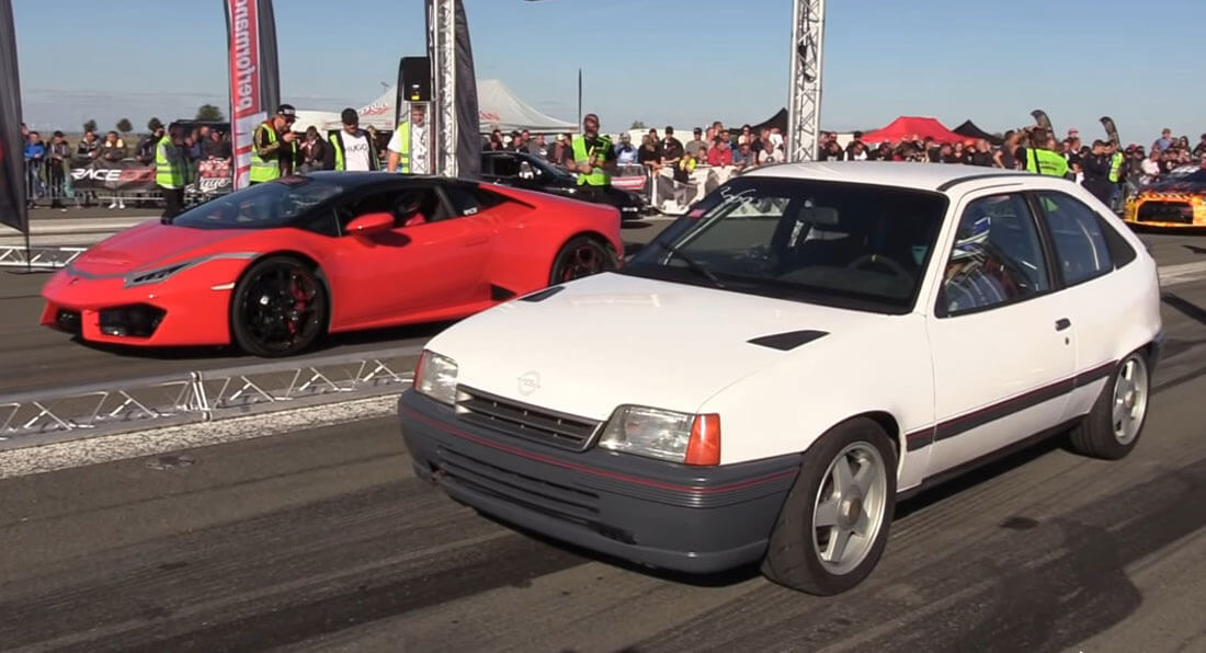 Car battles attract all sorts of participants sometimes… Just look at this antiquated and shabby Opel Kadett challenging the opulent Lamborghini Huracan supercar to a drag race…