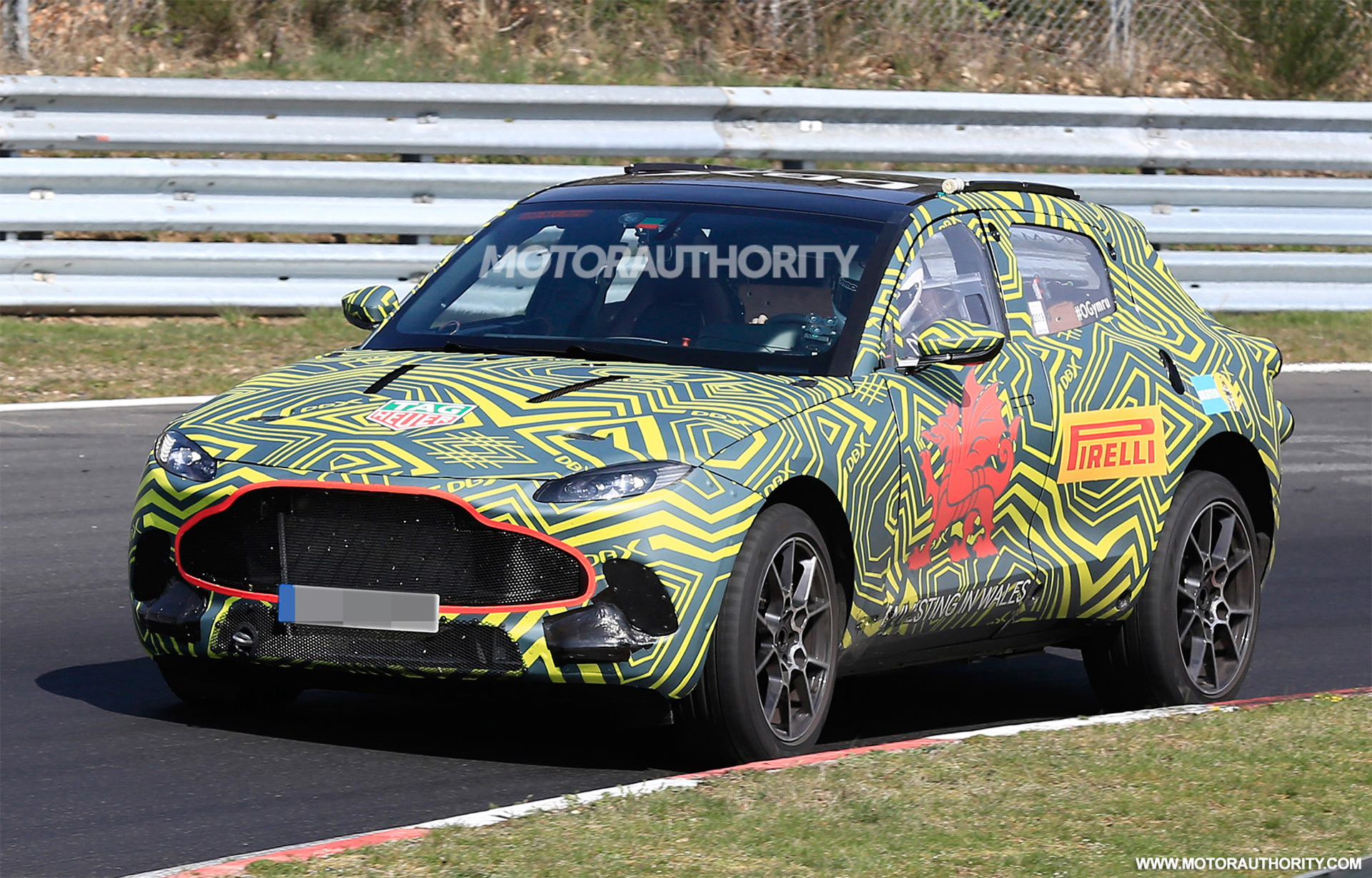 According to these latest discreetly made shots, Aston Martin has begun testing its first crossover/SUV on the Nürburgring Circuit in Germany