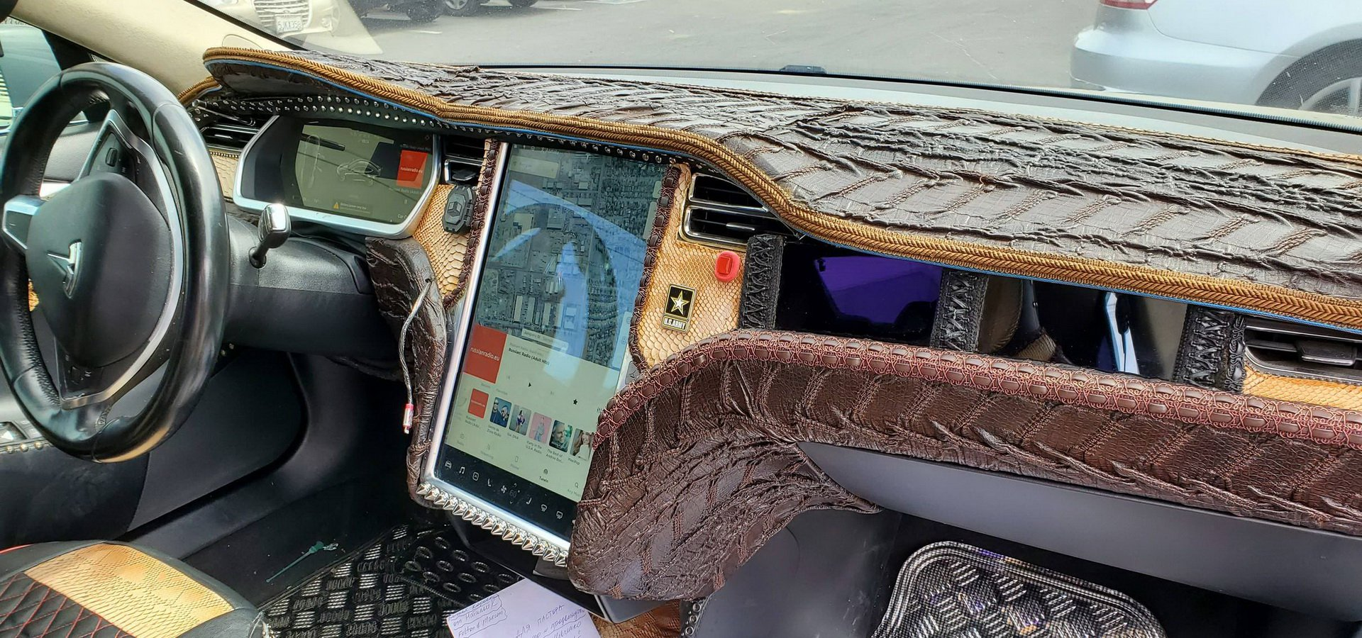 This is a Tesla Model S that we have here. Apparently, its owner felt like wrapping its entire cabin in all imaginable kinds of gaudy-looking, eye-watering crocodile leather