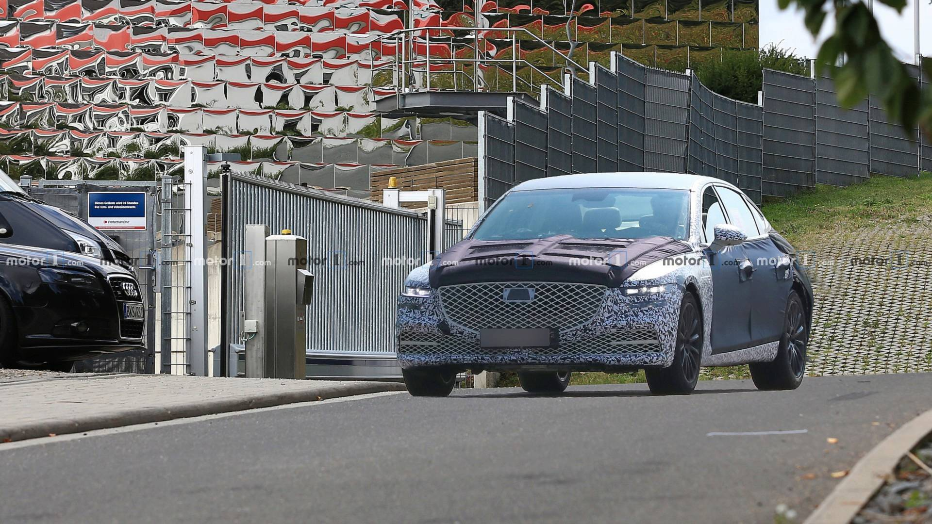 Another portion of spy photos depicting the new Genesis G80 sedan/saloon has emerged online. Allegedly, the photographer spotted the car running at full throttle at the Nürburgring Circuit in Germany.
