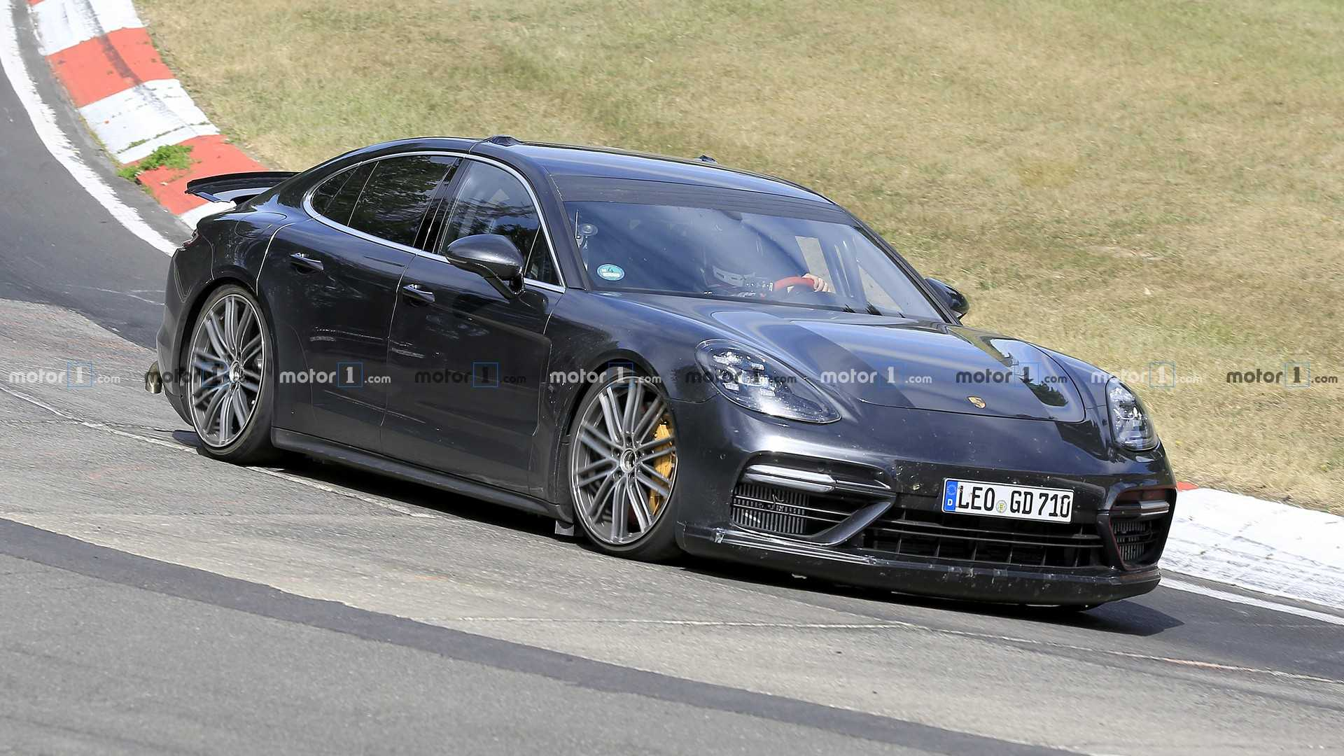 A highly unusual test build of the Porsche Panamera has recently been spotted making circles at the Nürburgring Complex in Germany. The car had quad tailpipes facing down and an extremely low ride height.