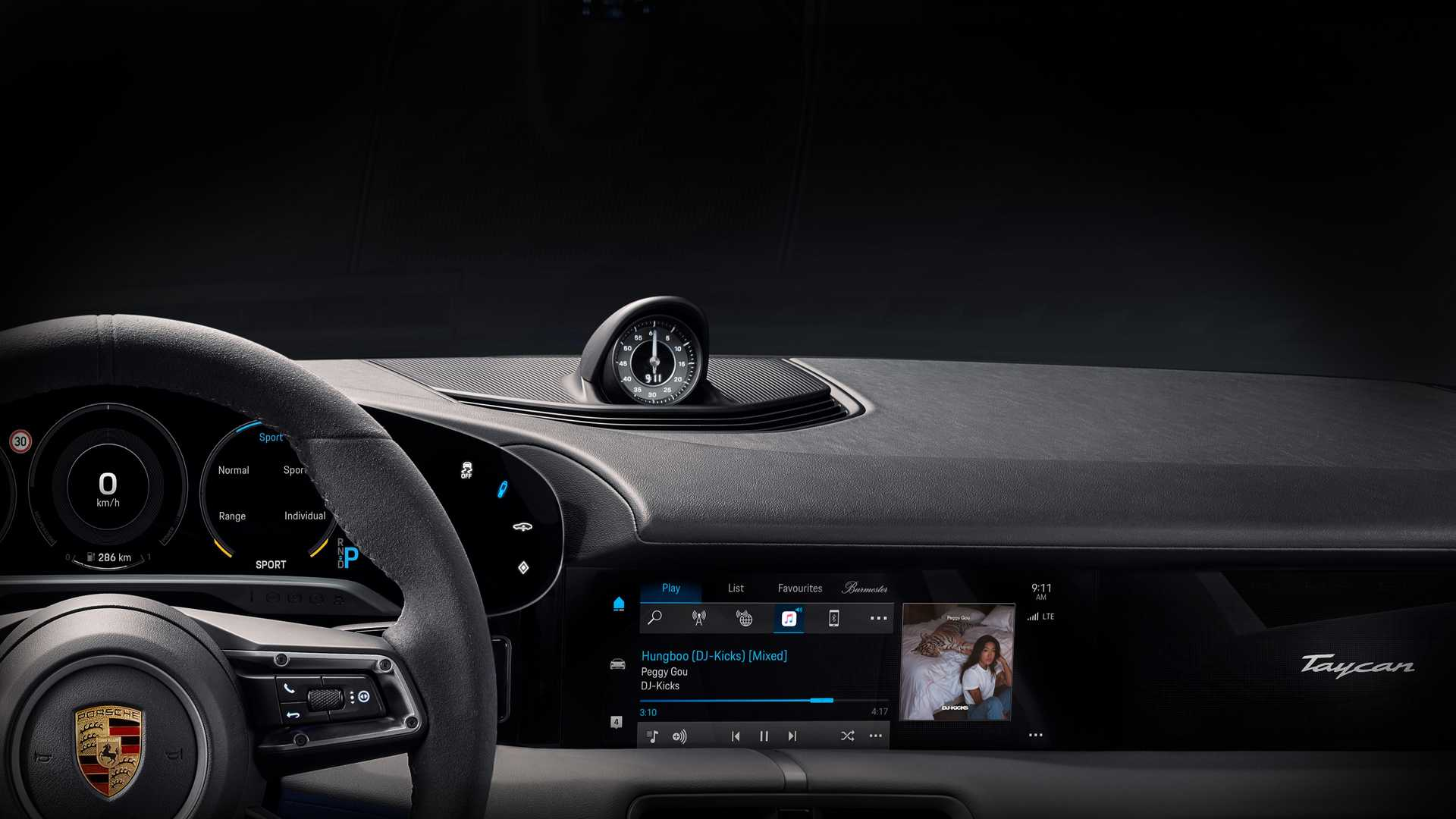 The first official photo revealed by Porsche shows some of the dashboard of the impending Taycan EV.