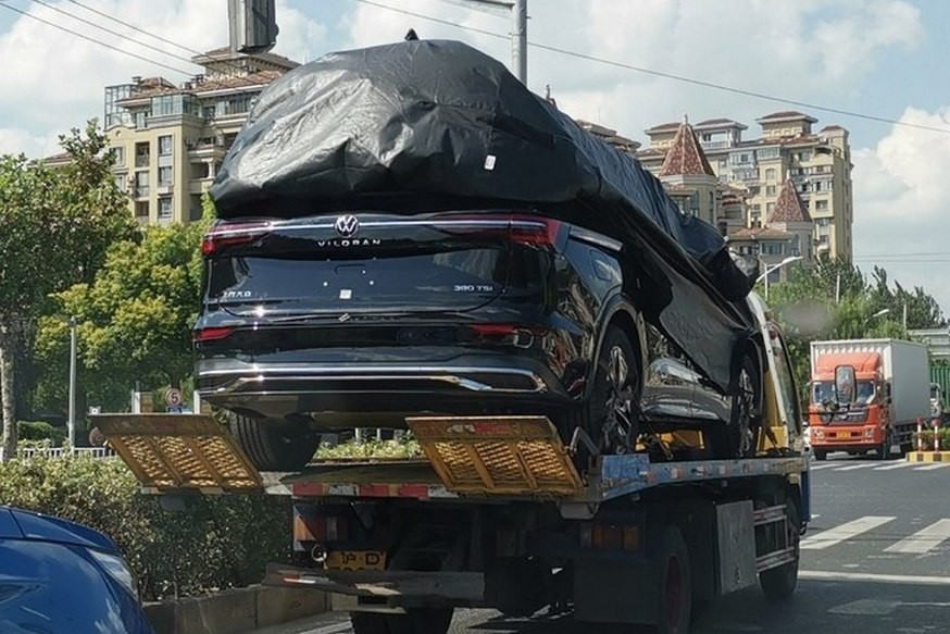 Media first learned last fall that Volkswagen AG was working on a new MPV. Since then, several sets of spy photos showing a camouflaged prototype of the vehicle have been posted online. A few days ago, spotters have tracked down and photographed the van in its final production version – and with the rear end exposed.