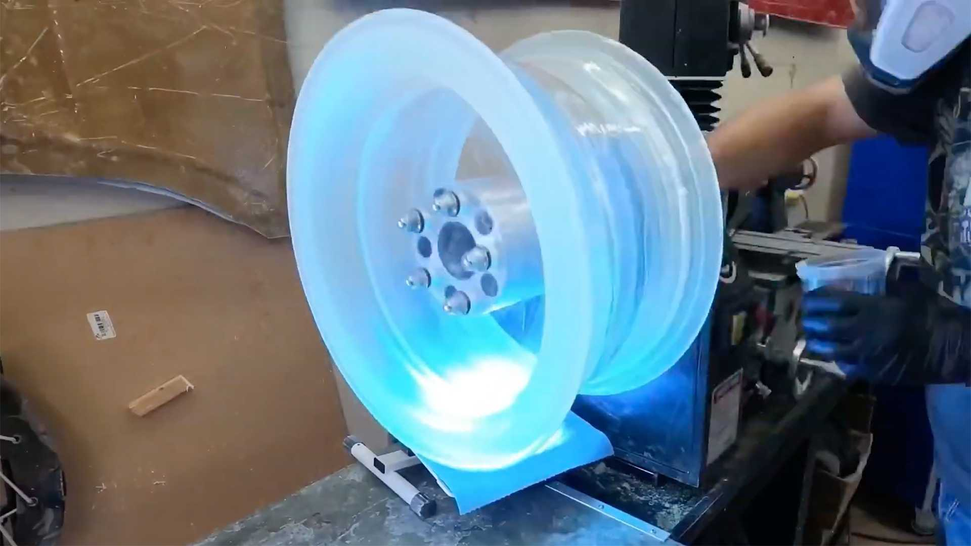 A car repairman from Michigan, USA, has found a way to produce spokeless car rims using clear epoxy. The video shows one such wheel fitted with LEDs for maximum eye candy.