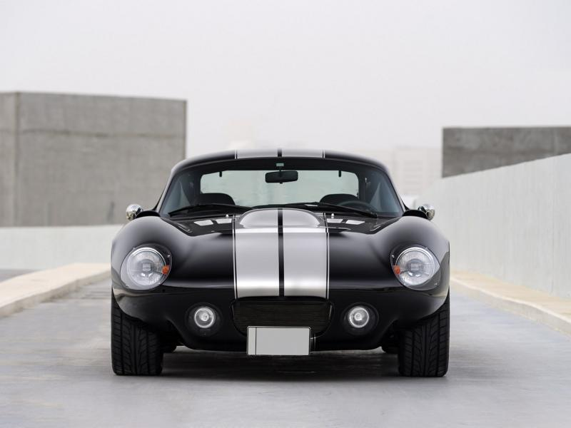 Back in 1964, Carroll Shelby built the original Daytona coupe to challenge the Ferrari in the GT racing series. With its unmistakable AC Cobra looks and a potent 4.7-liter Ford V8 under the hood delivering 380 hp (283 kW) to the wheels, it sprinted 0-100 km/h (0-62 mph) in mere 4.4 seconds. Shelby assembled a total of six such vehicles, not all of which survive to this day.