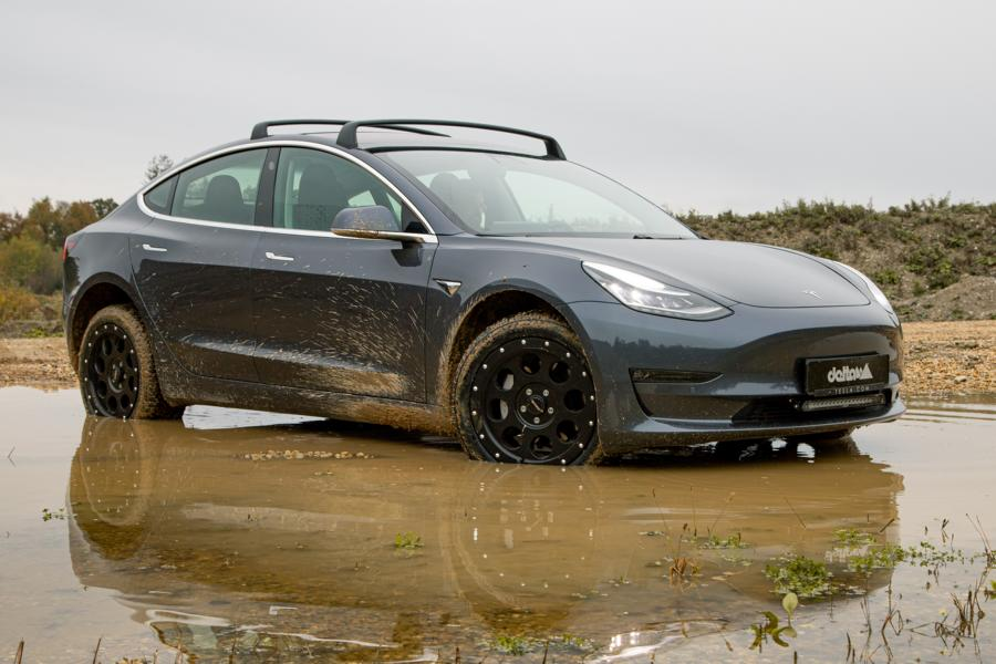 Delta4x4 outdid itself when it converted Elon Musk's electric sedan into a capable rally car and immediately let it ride through mud, dirt, and gravel.