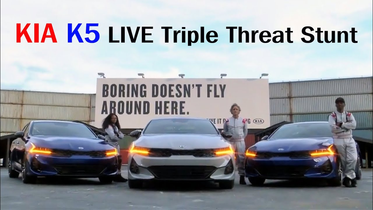The U.S. subdivision of Kia has come up with a creative, if risky, way to advertise its upcoming K5 update. The latest ad shows two business sedans run up a ramp and leap onto the other side over a 10m (30ft) wide gap, while a third car does a police turn underneath.