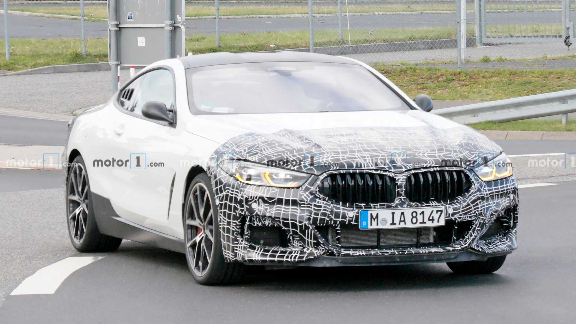One might think this BMW 8 Series test mule recently spied at the Nürburgring is just a regular coupe partially wrapped in camo, but a number of signs indicate that it may very well be a mid-engined track tool with much more to it than meets the eye.