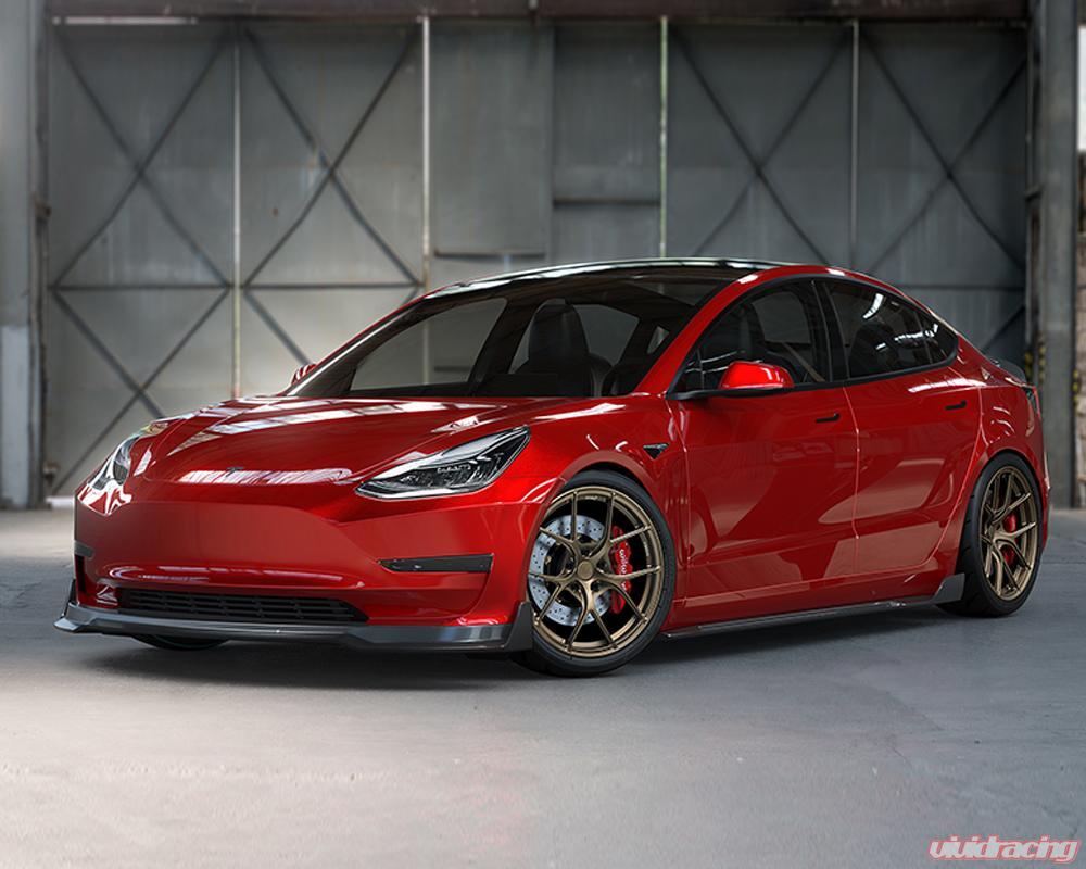 Малоизвестное тюнинг-ателье Vivid Racing из Аризоны предлагает улучшить внешность бюджетного электроседана Tesla Model 3 при помощи недорогого аэродинамического обвеса из углепластика.