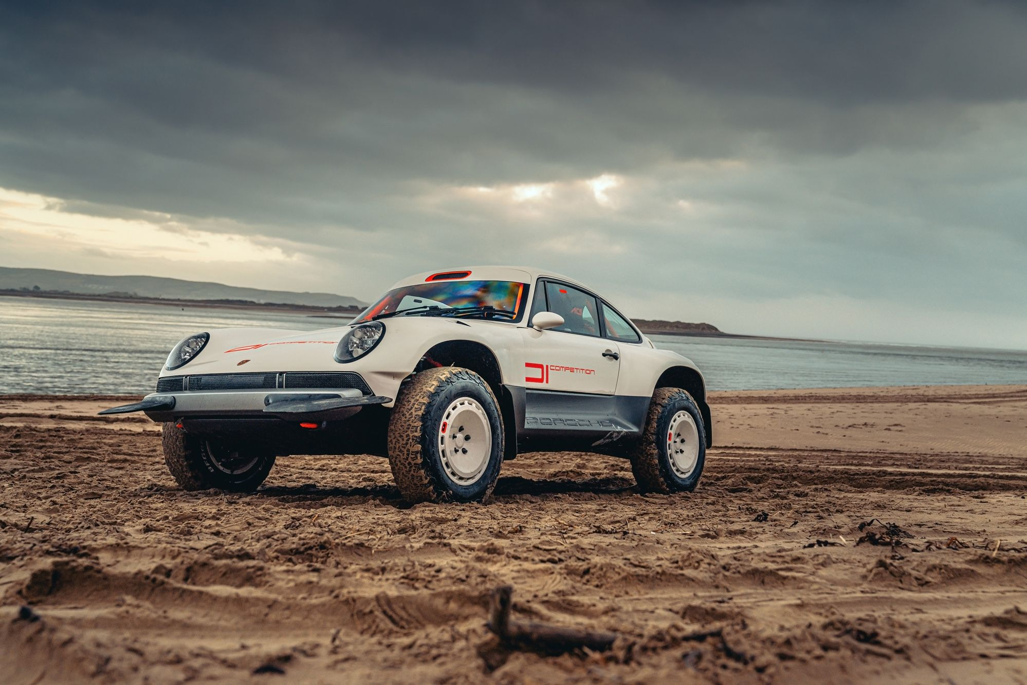 A client of Singer Vehicle Design wanted to participate in serious rallies, including the Dakar Rally and Baja 1000, so he ordered two custom 4WD Porsche 911s.