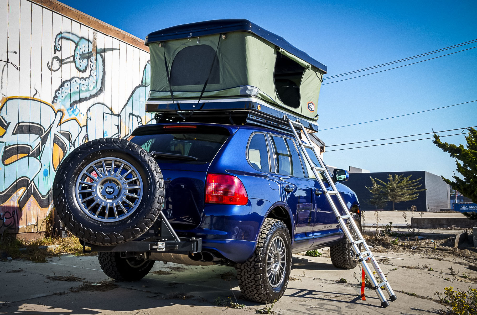 Bring-a-Trailer is offering a rather impressive-looking blue 2006 Porsche Cayenne Turbo S remodeled into a serious SUV for off-roading and camping.