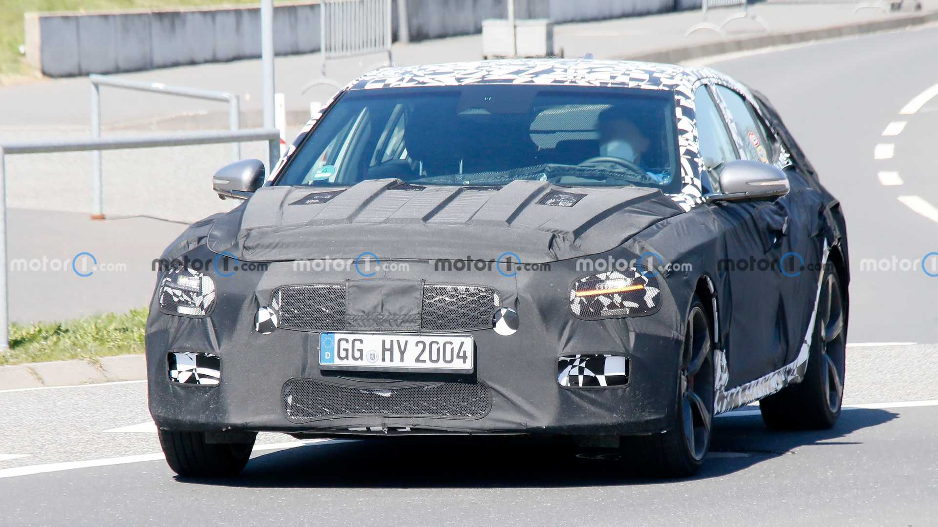 Camera-wielding spies first spotted the wagon version of the Genesis G70 nine months ago, so it would be about time for the car to start shedding its camo. However, the prototype detected this weekend in the Nürburgring paddock continues to hide itself under thick wrap and faux paneling.