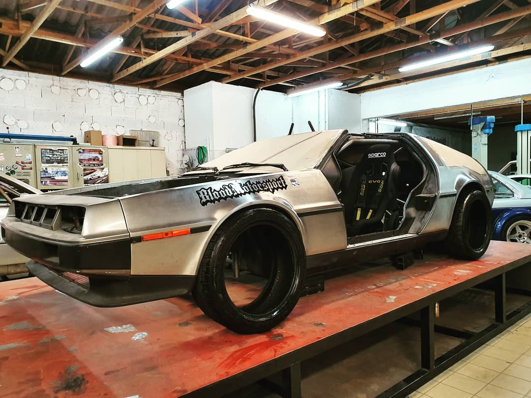 French professional racer Alexandre Claudin has teamed up with three tuners on a three-year-long project to squeeze an American V8 into the front end of a DeLorean DMC-12.
