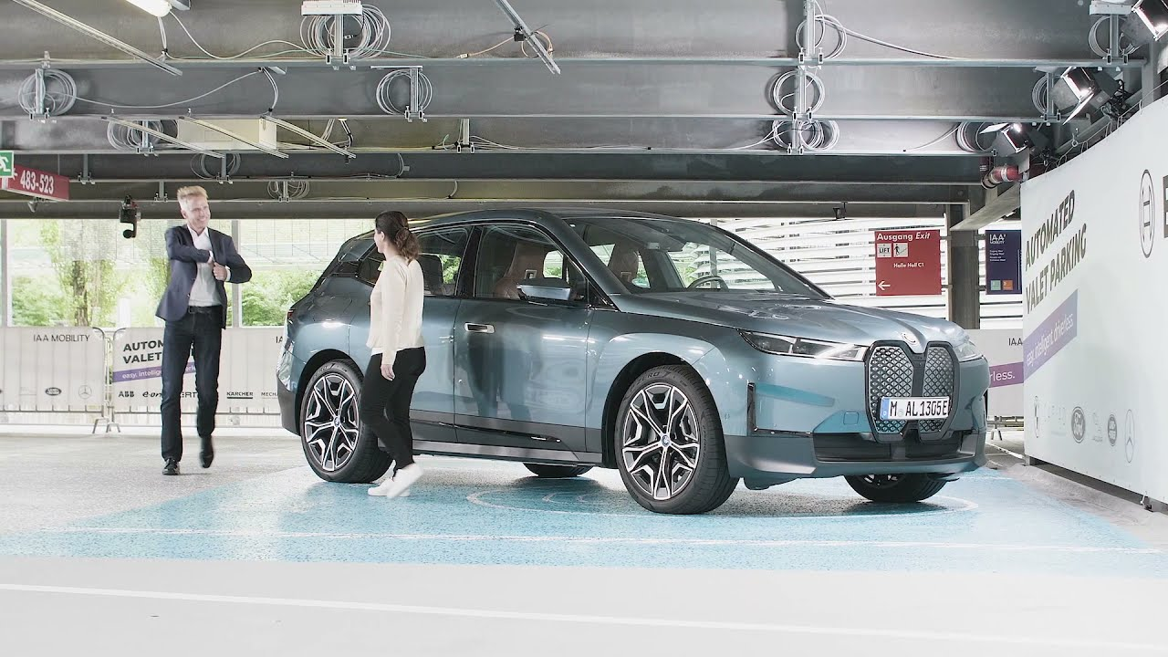 The latest promotional video from BMW shows the semi-autonomous electric SUV, BMW iX, finding a free spot on a parking lot, charging its battery, and driving itself to a carwash.
