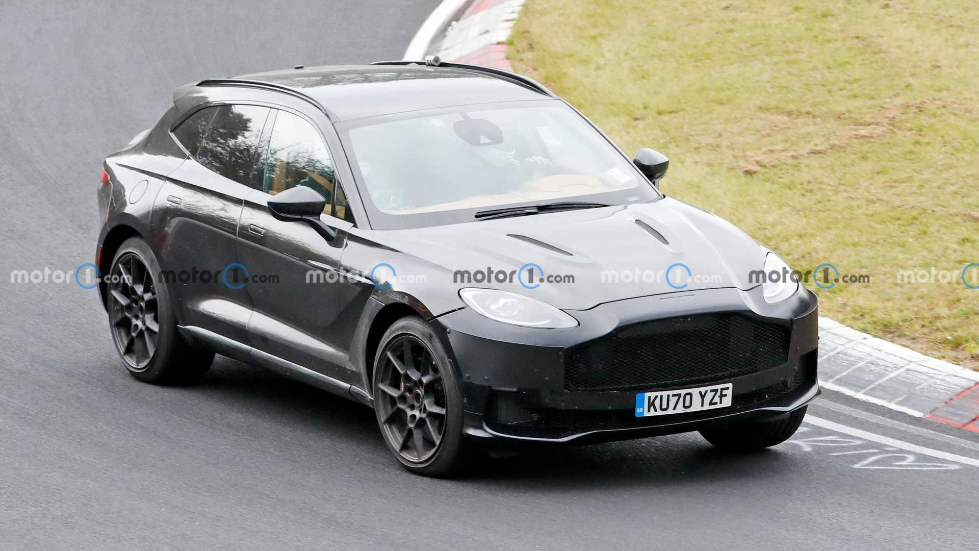 The DBX is a crucially important vehicle for Aston Martin, which relies on it to generate most of its revenue. The future of the DBX family envisions no less than six different models, and it looks like one of them has just been spotted going fast on the North Loop.