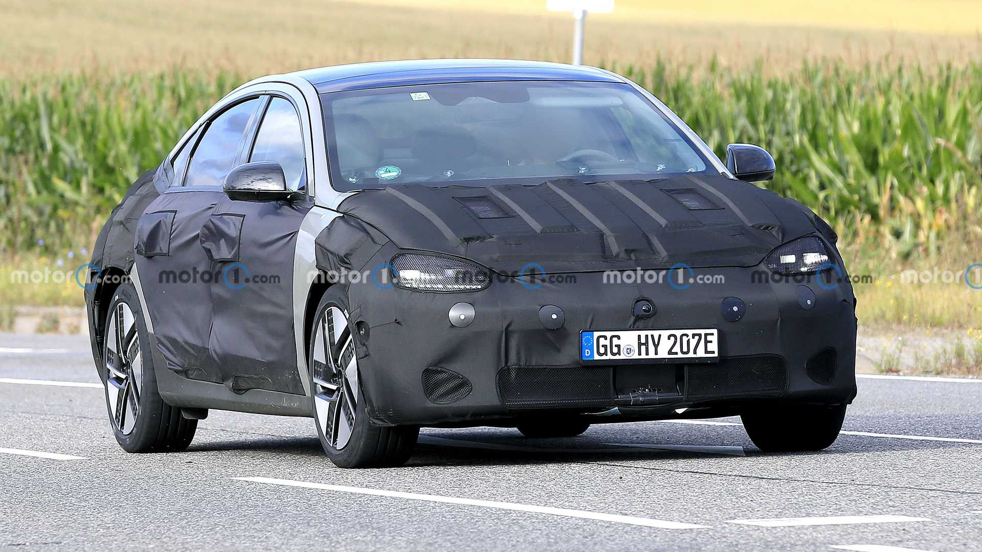 If you hoped that the Hyundai Ioniq 6 would preserve all the bells and whistles the Prophecy Concept (see video) had, we have disappointing news for you. Here are spy photos of a pre-production car that looks considerably trimmed down from the initial design.