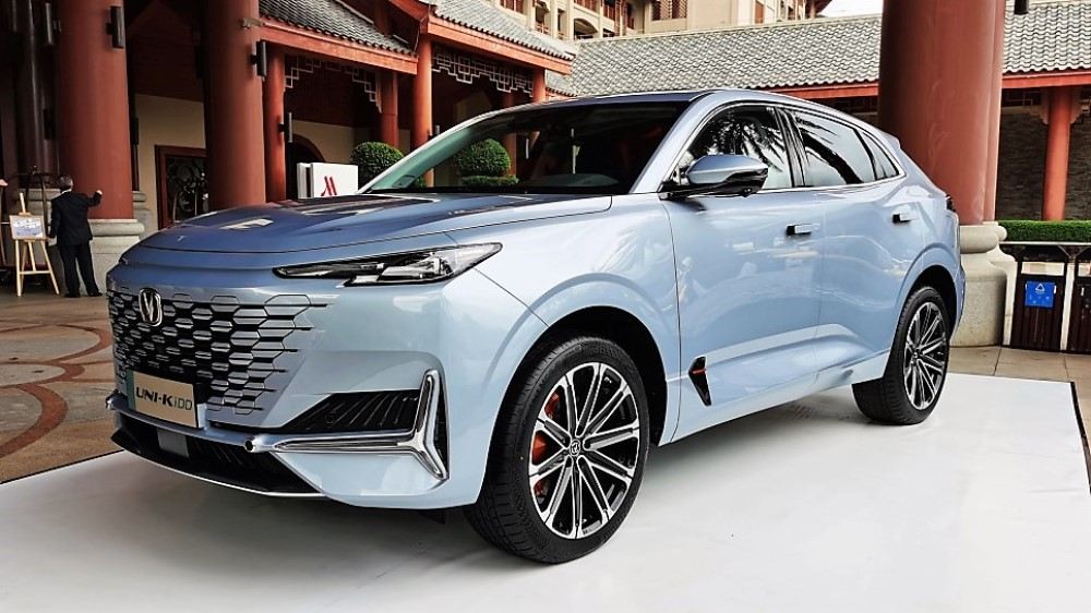 Changan has unveiled a part-electric modification of its Uni-K crossover SUV, which looks nearly identical to its ICE counterpart on the outside except for dual tailpipes and a tiny badge reading 'IDD' (the name of the powertrain).