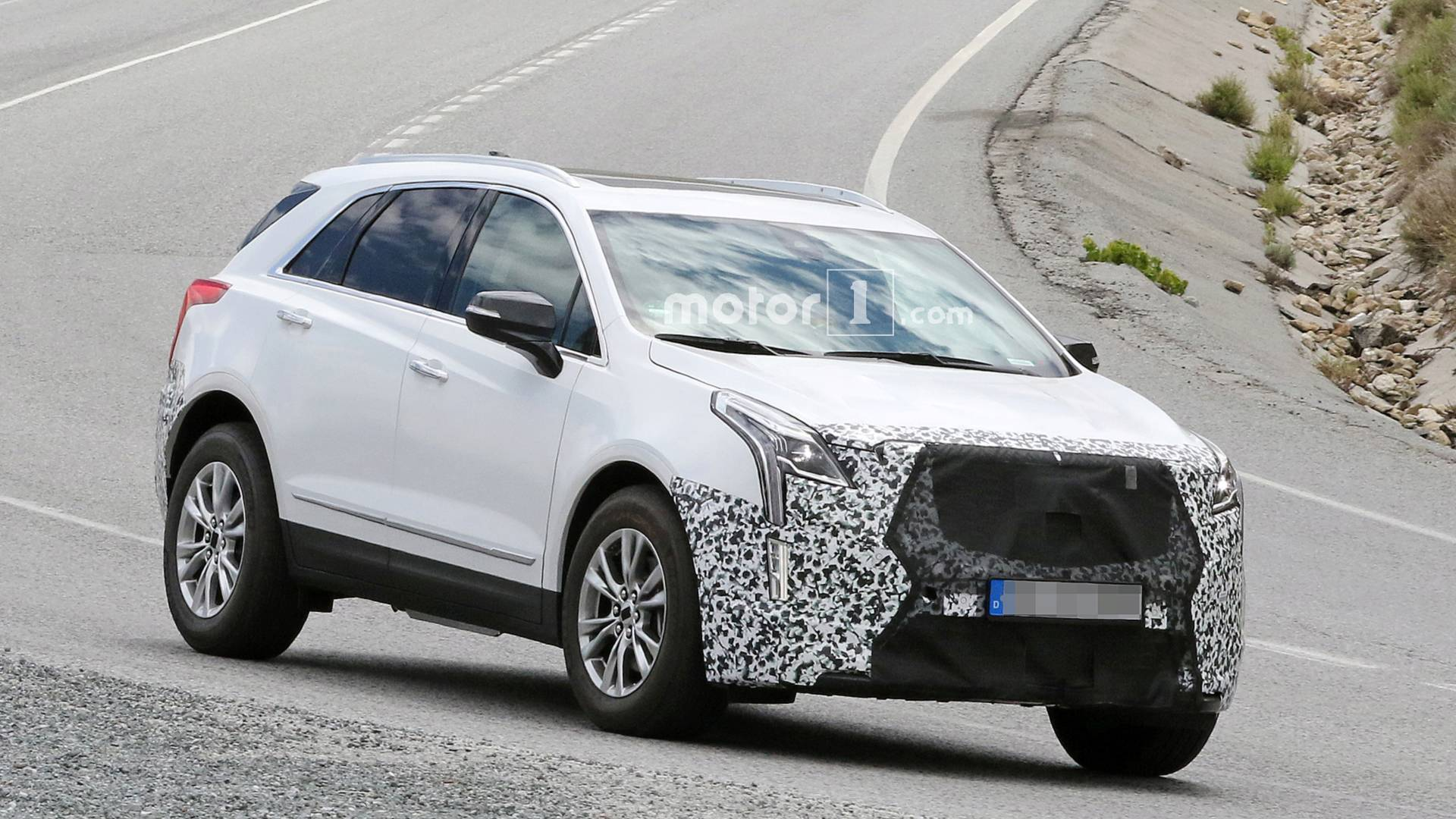 Car photographers have managed to take a series of photos of the shiny new Cadillac XT5 running some initial road tests ahead of its premiere in early 2019